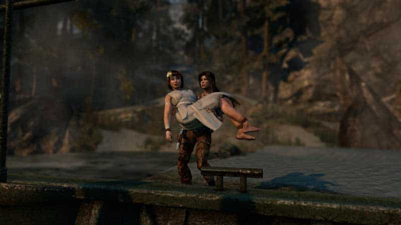 Lara Croft cargando a Sam